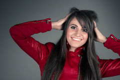 Beautiful young brunette woman wearing red leather jacket Royalty Free Stock Photos