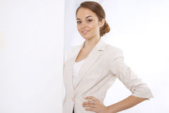 Beautiful young brunette woman with a white banner Royalty Free Stock Photography