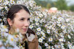 Beautiful young brunette woman in white  flowers outdoors Stock Photos