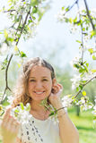 Beautiful young brunette womannear the apple tree Royalty Free Stock Photo
