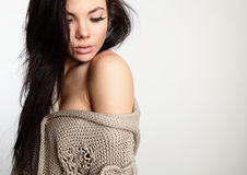 Beautiful young brunette in woollen sweater Royalty Free Stock Image