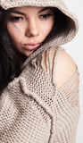 Beautiful young brunette in a woollen sweater Stock Images