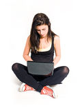 Beautiful young brunette working with laptop. Stock Images