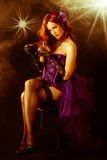 Beautiful young burlesque showgirl on stage. Royalty Free Stock Photography