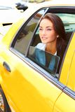 Beautiful young business female riding in taxi Stock Photos