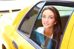 Beautiful young business female riding in taxi Royalty Free Stock Photo