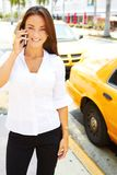 Beautiful young business female talking on cell phone Stock Photos
