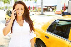 Beautiful young business female talking on cell phone Royalty Free Stock Photos