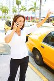 Beautiful young business female talking on cell phone Royalty Free Stock Photo