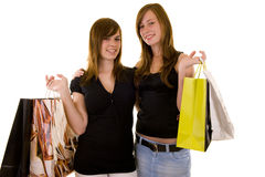 Beautiful young business ladies. Indicating and shopping, looking happy, isolated on white stock images