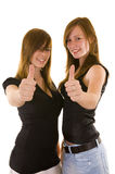 Beautiful young business ladies. Indicating thumbs up and smiling, isolated on white stock photo