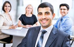 Business man with colleagues. Beautiful young business men with colleagues discussing in the background Royalty Free Stock Images