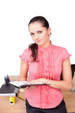 Beautiful young business woman. Taking notes at the office Royalty Free Stock Photos