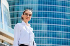 Young business woman on the background of skyscrapers Royalty Free Stock Photos
