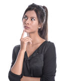 Beautiful young business woman in a black dress isolated. Isolated young businesswoman in a black outfit - sceptical and pessimistic Stock Image