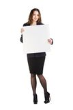 Beautiful young business woman with blank board Stock Images