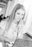 Beautiful young business woman eating ice cream at Stock Image