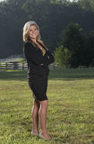 Beautiful young business woman on farm Stock Photo