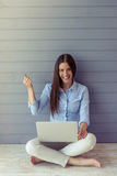 Beautiful young business woman with gadget Stock Photos