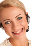 Beautiful young business woman with headset Royalty Free Stock Photography