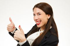 Beautiful young business woman, with her thumbs up. Isolated on white background Stock Photography