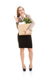 Beautiful young business woman holding box with personal things. Stock Photo