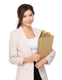 Beautiful young business woman holding document work Stock Image