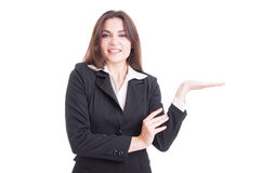 Beautiful young business woman holding nothing on palm Royalty Free Stock Image