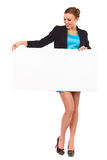 Beautiful young business woman holding white banner. Stock Photos