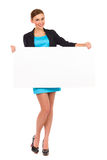 Beautiful young business woman holding white banner. Stock Photo