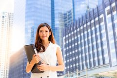 Beautiful young business woman just graduated from University, a royalty free stock image