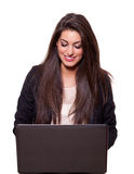Beautiful young business woman with a laptop. Smiling   (isolated on white background Stock Photo