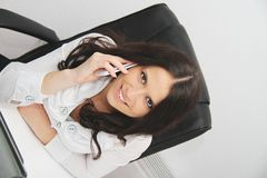 Beautiful young business woman with laptop in office Stock Images