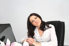 Beautiful young business woman with laptop in office Royalty Free Stock Photo