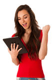 Beautiful young business woman looking at tablet gesturing succe Royalty Free Stock Image