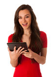 Beautiful young business woman looking at tablet gesturing succe Stock Image