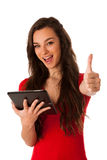 Beautiful young business woman looking at tablet gesturing succe Royalty Free Stock Photos