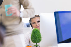 Beautiful young business woman in modern office Stock Photography