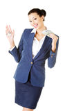 Beautiful young business woman with money and keys. Stock Images