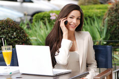 The beautiful young Business woman with movil. Outdoors Stock Photos