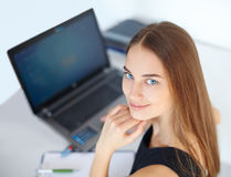 Beautiful young business woman in office Royalty Free Stock Photos