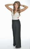 Beautiful young business woman in pants suit Stock Image