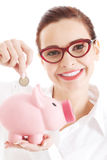 Beautiful young business woman with piggy-bank. Stock Photography