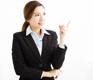 Beautiful young business woman pointing and looking Stock Image