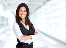 Beautiful young business woman. Portrait of happy young business woman over office background Royalty Free Stock Images
