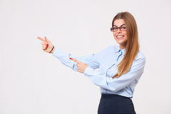 Beautiful young business woman presenting copyspace Stock Photo