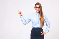 Beautiful young business woman presenting copyspace Royalty Free Stock Image