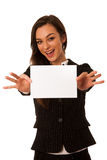 Beautiful young business woman showing a blank card isolated ove Stock Photos