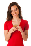 Beautiful young business woman showing a happy note on her smart Stock Photo