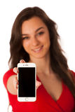 Beautiful young business woman showing a happy note on her smart stock photography